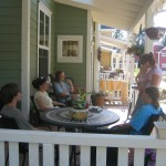 Neighbors gather on the porch at Nevada City Cohousing